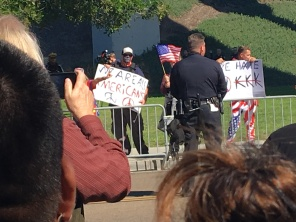 SDPD officer stands between Chicano Park event and the alt-right. Photo Credit: Roberto A. Camacho