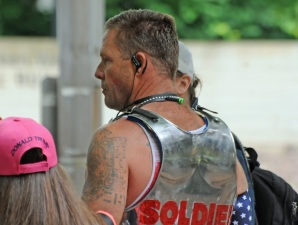 "John Turno aka 'Based Trojan' pictured above with ""white pride"" tattoos on both shoulders at a Portland rally in June 2017. Photo Credit: David Niewert."