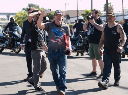 Among the crowd leaving the park a man in a NRA cap can be seen sporting a 'III% United Patriots' tattoo on his right forearm. Photo Credit: Brooke Binkowski